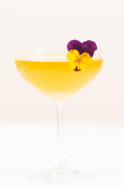 mixology photography at grand hyatt pansy flower drink